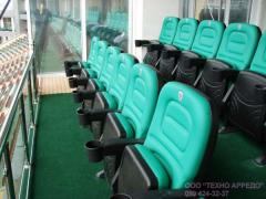 Seats for sports fans, chairs for the podium